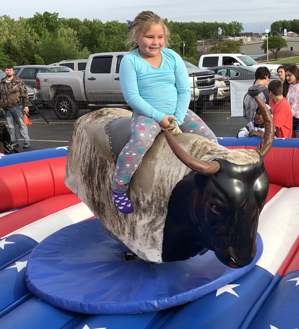 kid riding mechanical bull